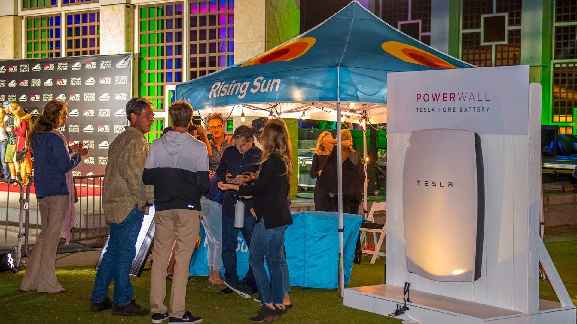 rising sun solar powerwall giveaway booth with people standing out front