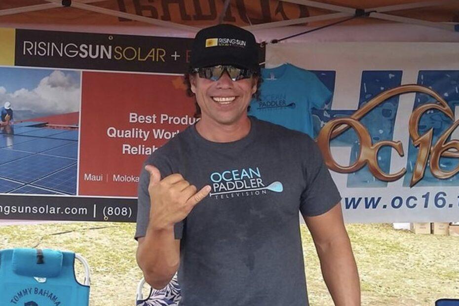 man giving shaka with rising sun solar hat