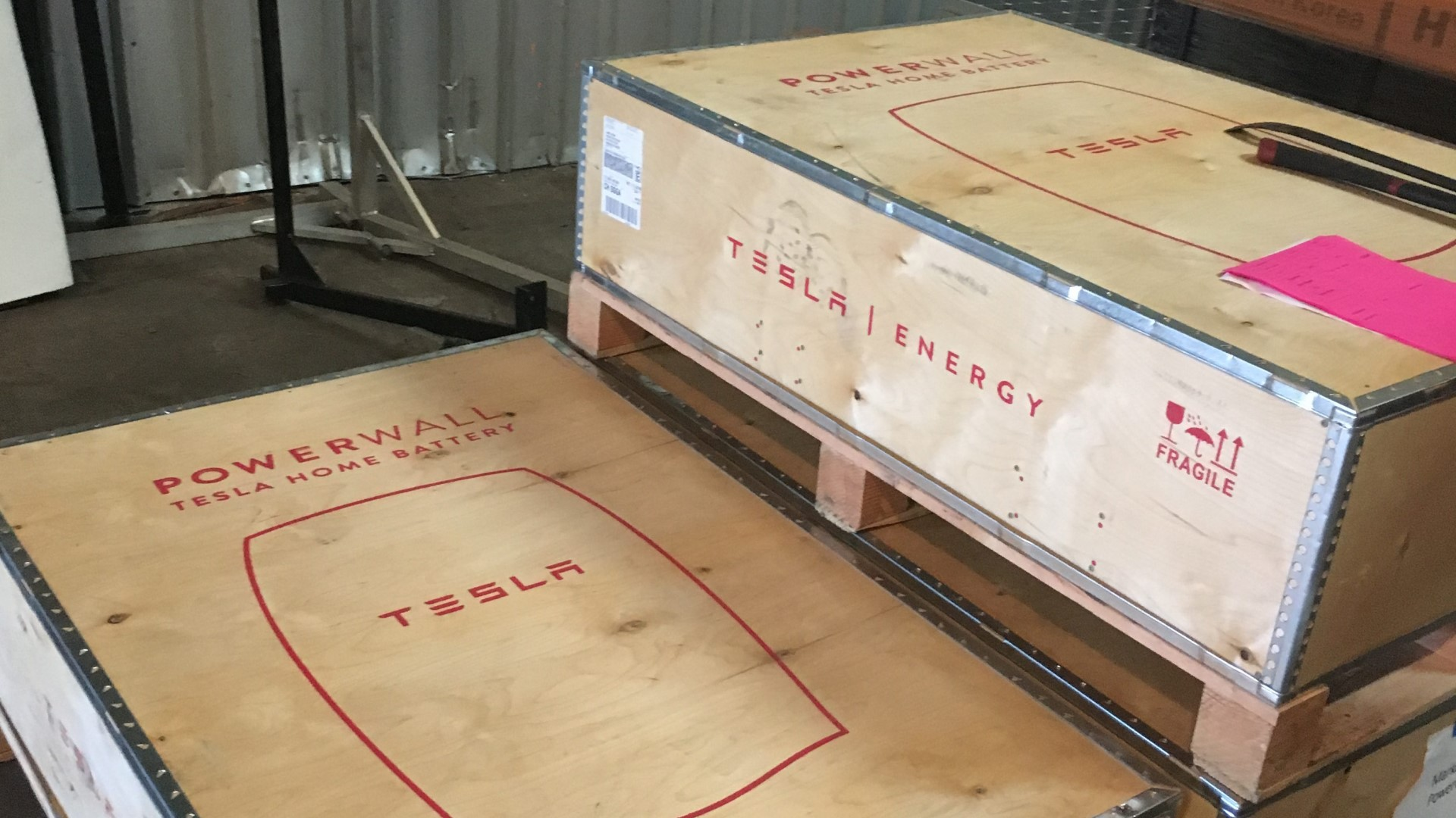 tesla powerwalls in their shipping boxes ariving at rising sun solars warehouse